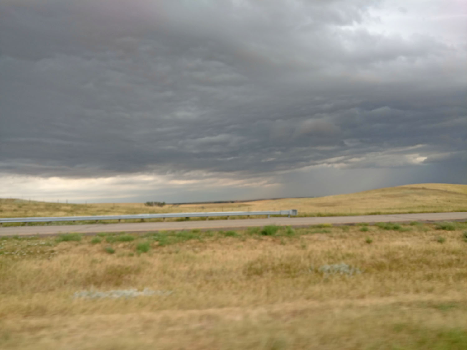 Storm clouds moving in, taken on the road this summer along I-90 somewhere in Wyoming