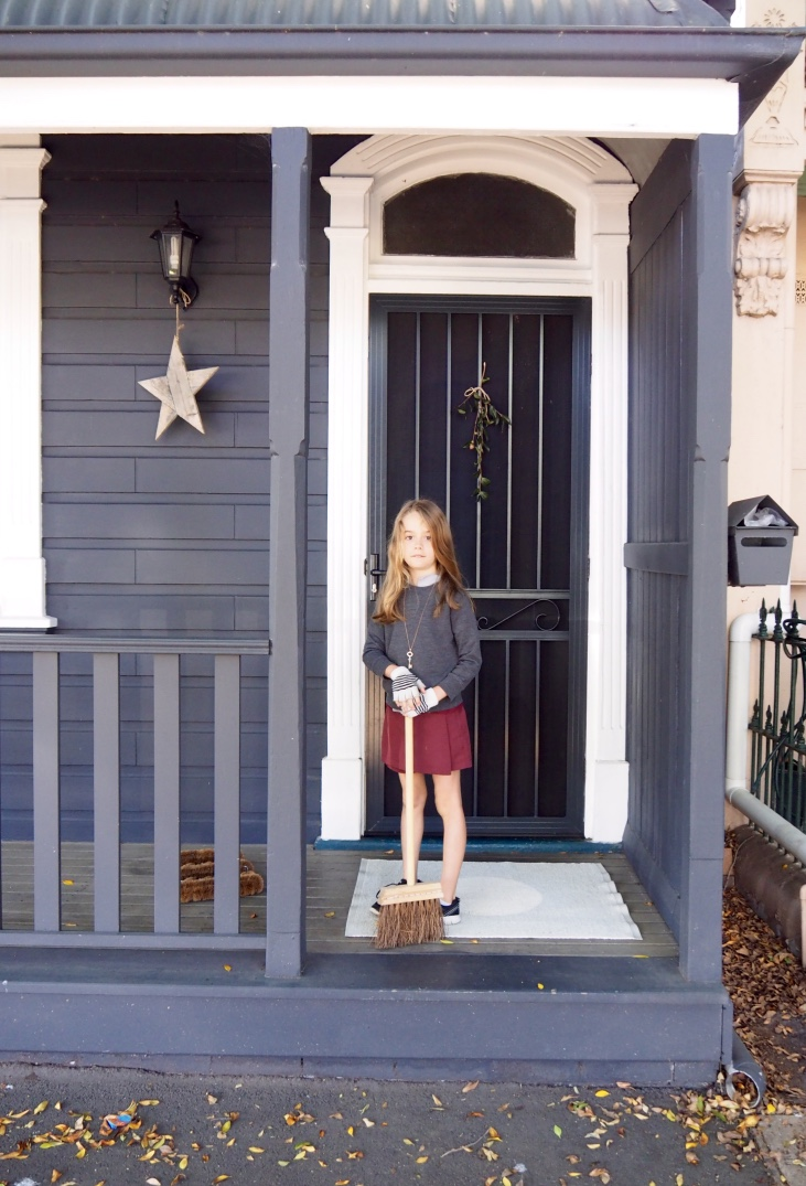 Ella gets in some sweeping with Pappa Sven's cute brooms. Photo: Sheriden Rhodes