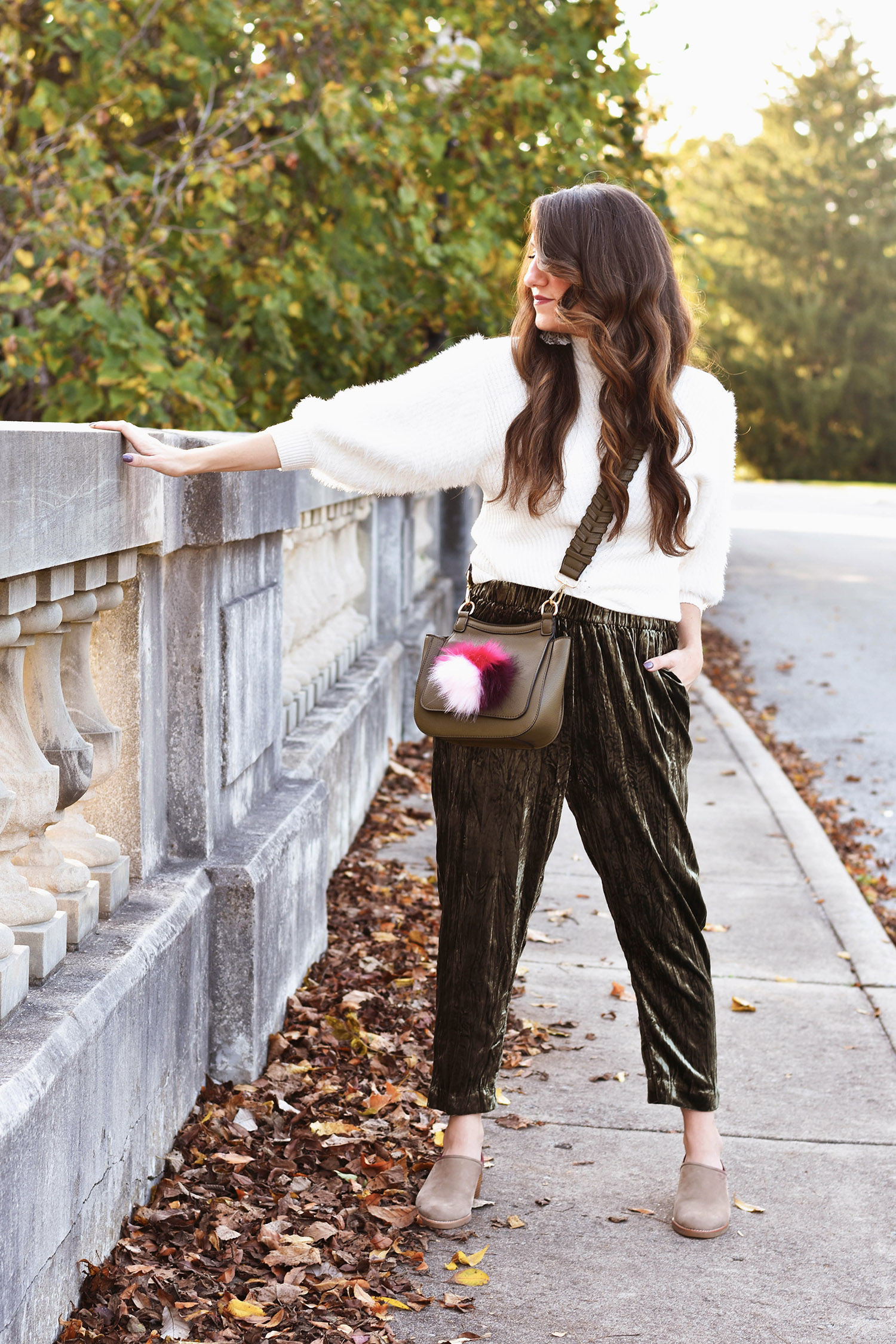 original post  here ]  ivory sweater ,  sweater  //  velvet pants  //  loafers ,  loafers ,  still my favorite mules  //  statement earrings  //  bag