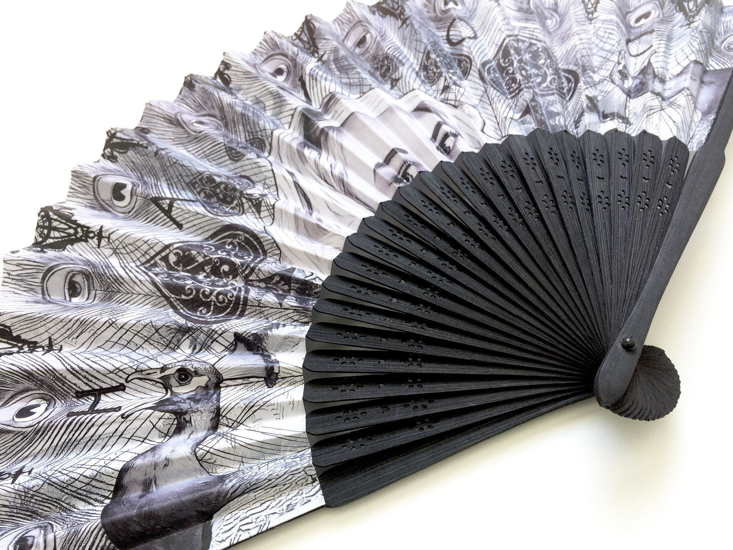 HAVOC Fan - Folding paper fan with a stylish black-stained bamboo handle featuring original digital collage artwork by Faye Havoc.