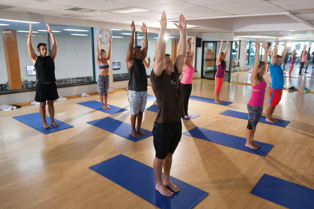 Group Yoga is one of over 100 classes offered each week at the Honolulu Club.