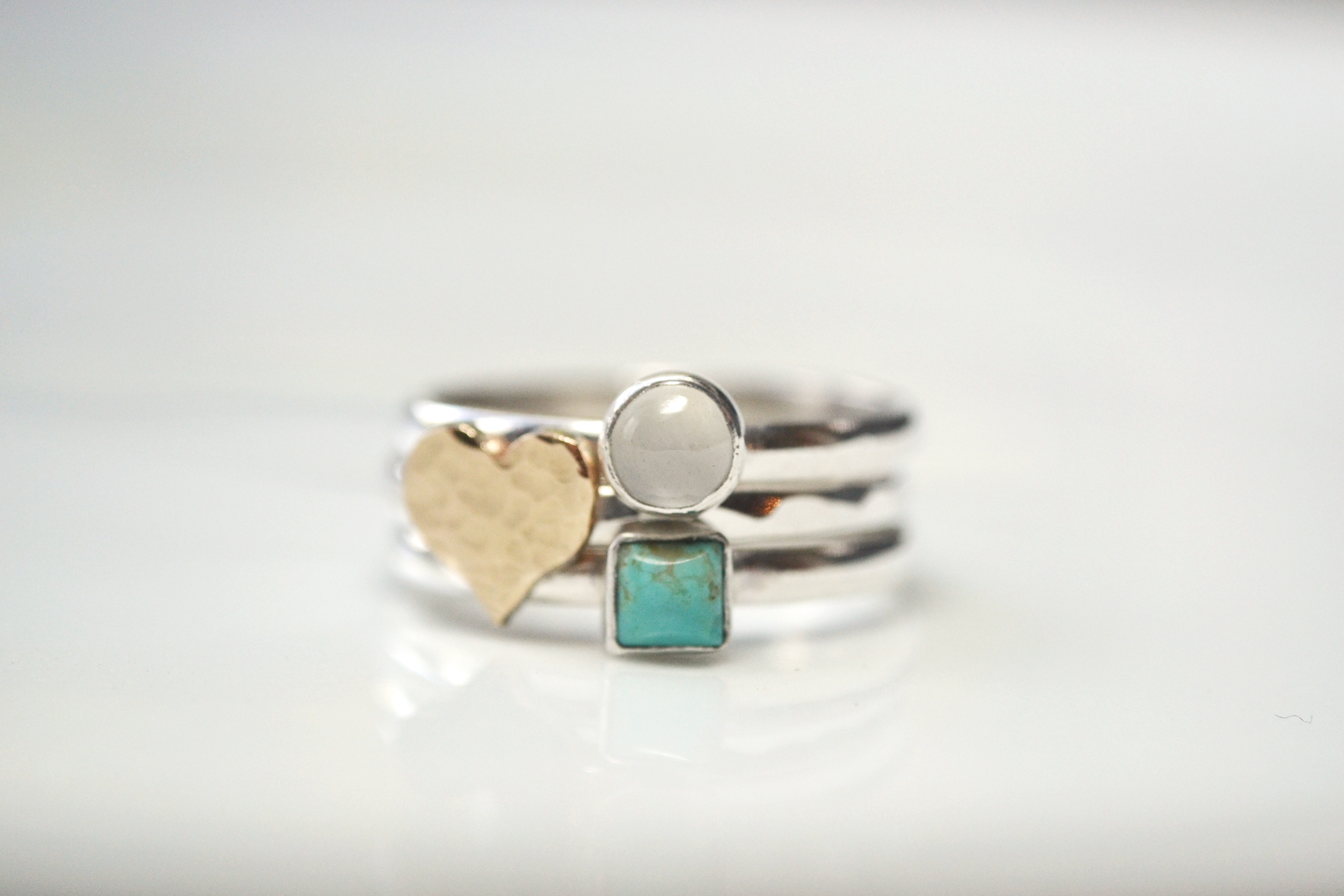 Gold heart with a 5mm moonstone and a 4mm turquoise square.
