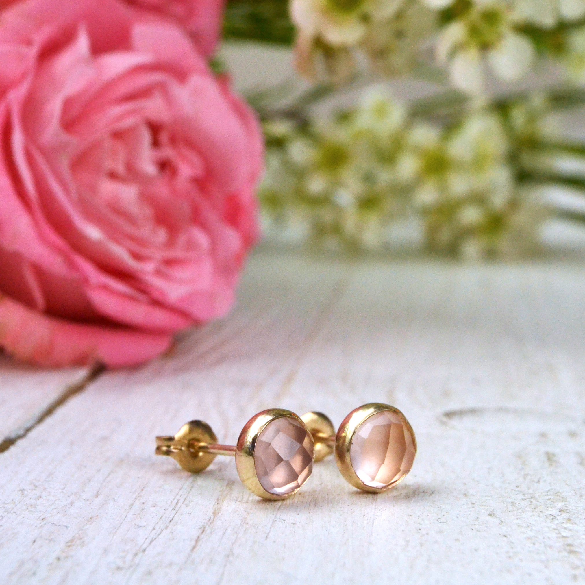 Rose quartz earrings in gold.  Honestly I didn't know these exsisted until today, but I have fallen in love with them.
