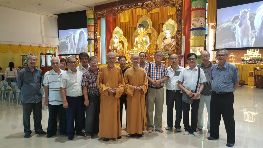 Mr Kng Wee Bin in checked shirt, standing to the right of Venerable Bensi.