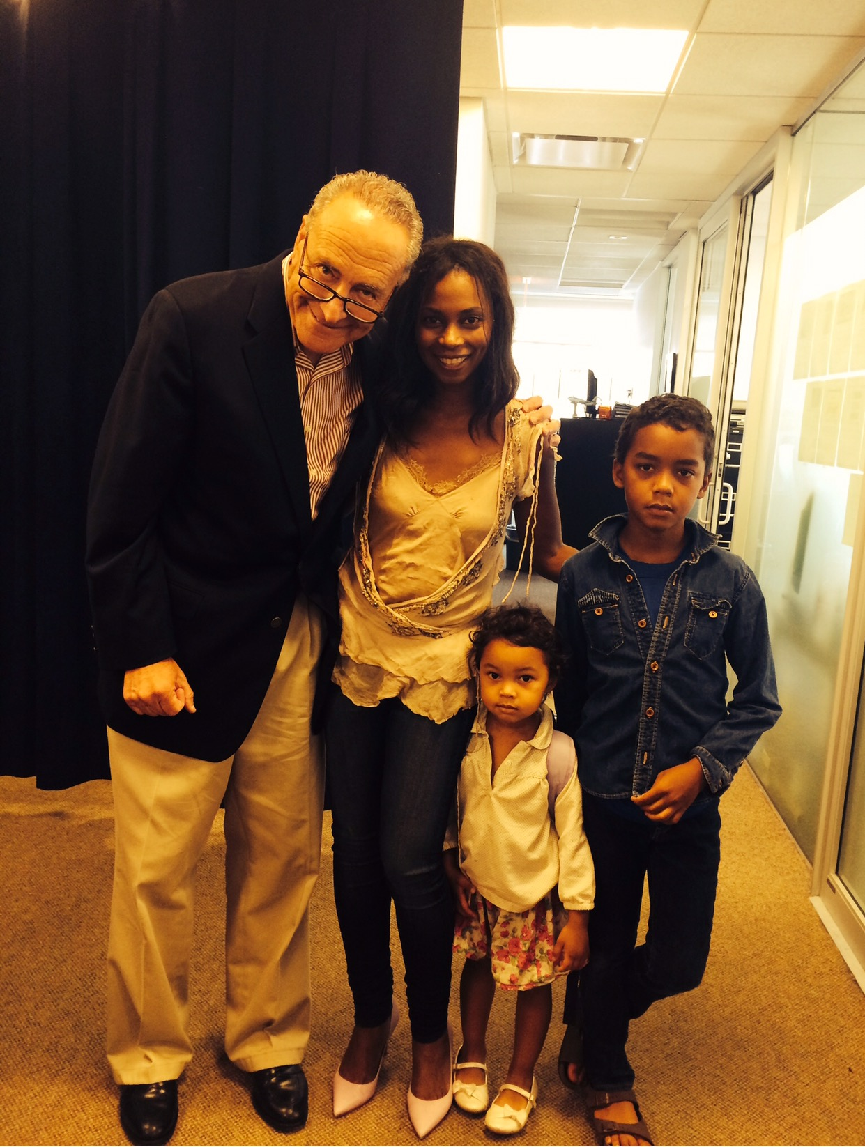 Penelope and her children with US Senator Charles Schumer