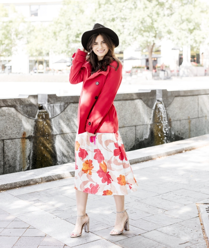 red jacket black hat floral dress