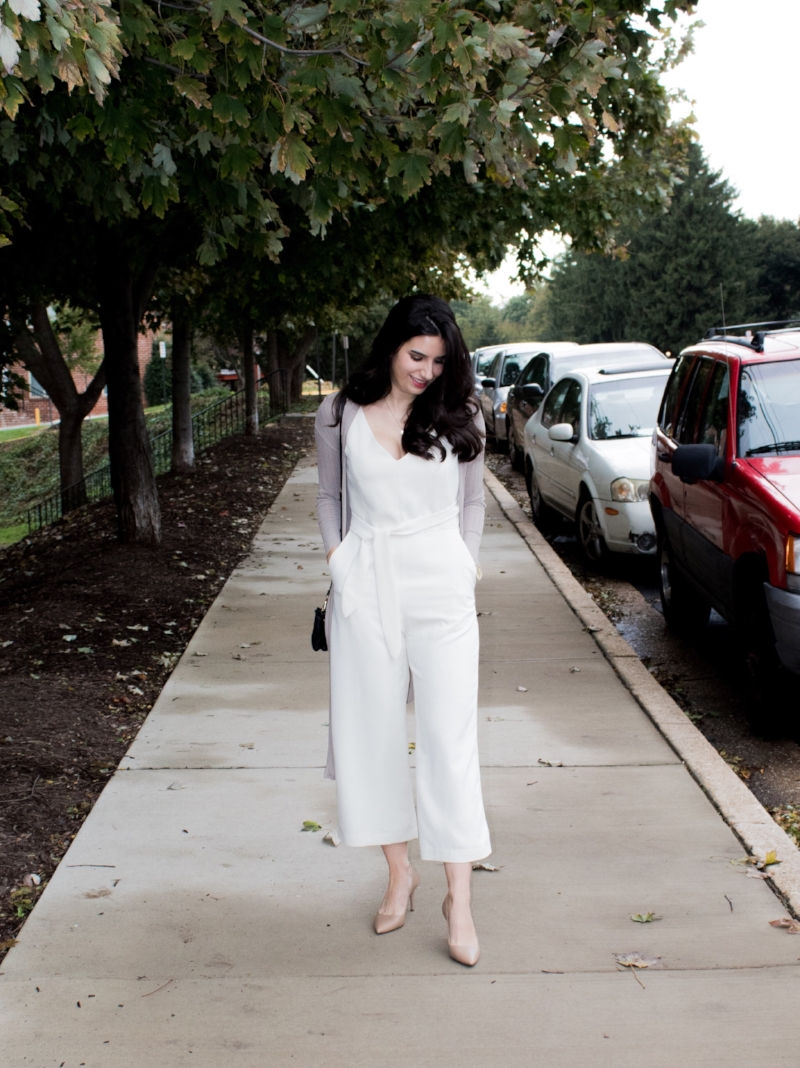 White jumpsuit with neutral sweater