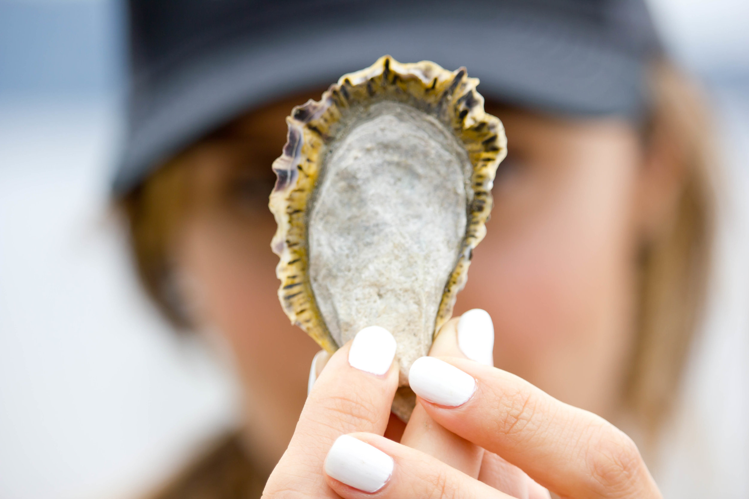 Sara with an Olympic Oyster. Credit: Miriam Sebring Photography.