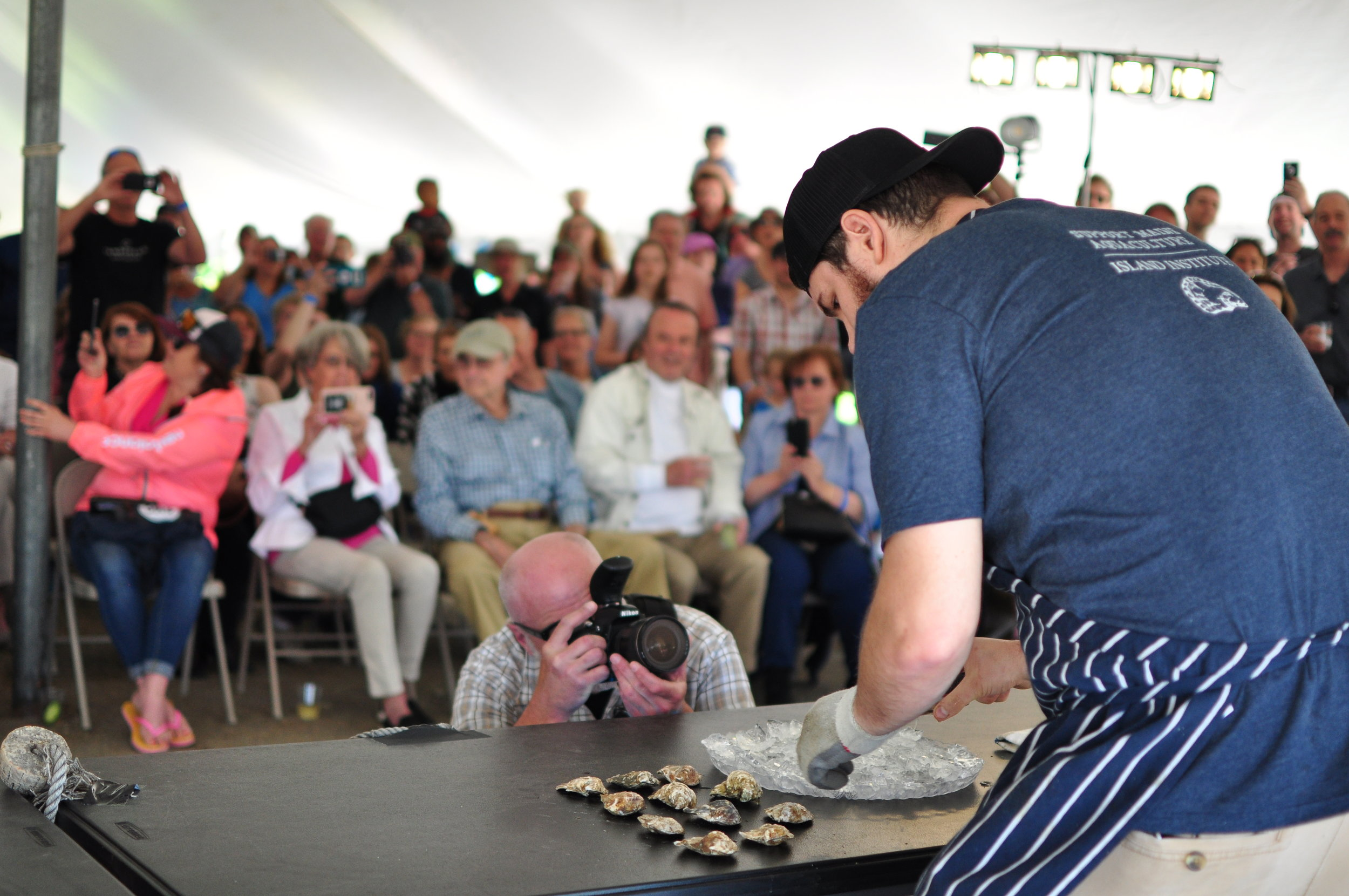 The shucking competition at the DOC sources somer of the very best shuckers in North America. Photographer: Warwick Ombler.