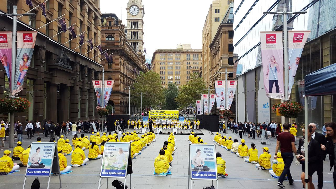Falun Gong practitioners raise awareness in Martin Place, Sydney.