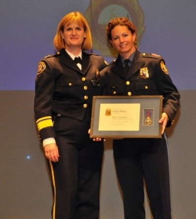 Chief Rosie Sizer awarding me the Police Medal in 2009.
