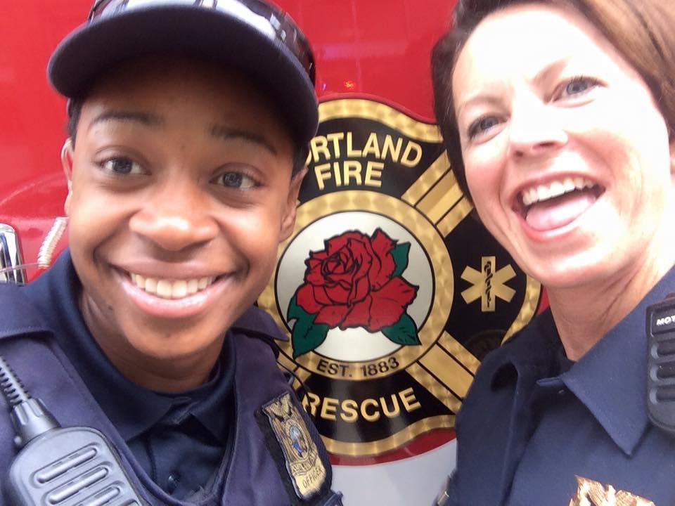 My friend Rashida and I having a little fun photo bombing the fire guys.