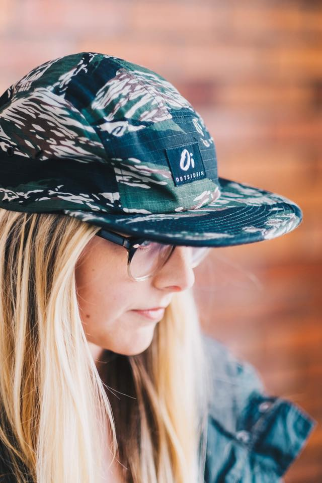 Blonde Girl Wearing an OutsideIn Camoflauge Five Panel Hat.jpg