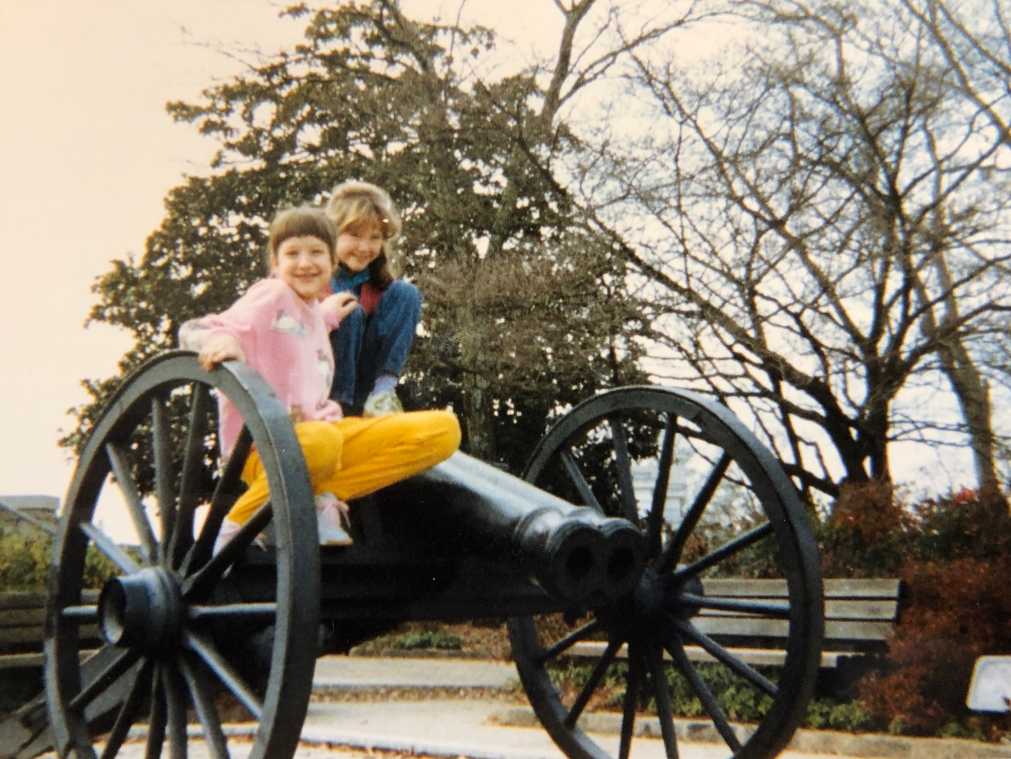 Me in the front (with yellow pants) posing on the double barrel cannon in downtown Athens with a childhood friend.