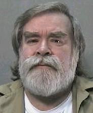 Cottingham older in a prison mugshot.
