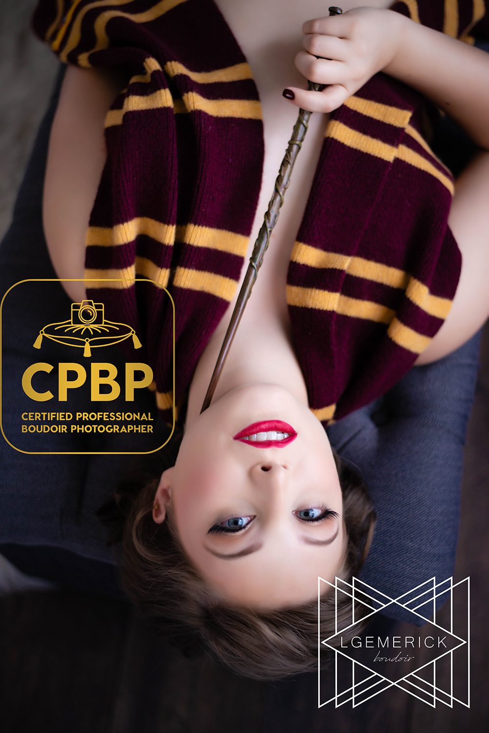 Beautiful young Caucasian woman with blue eyes and a Harry Potter Gryffindor scarf and Hermoine wand laying down for tasteful boudoir photography shoot by LGEmerick Photography in Kansas City Missouri