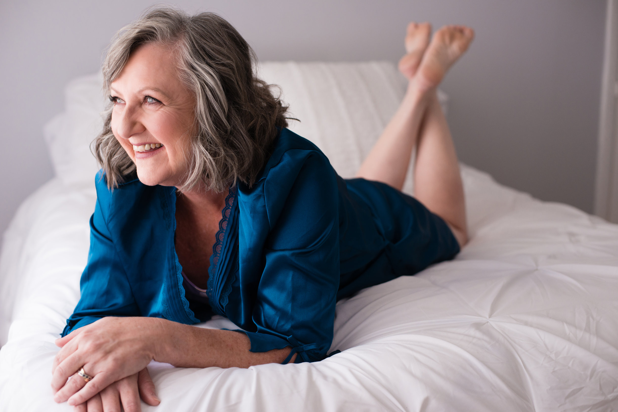 "Brave Boss Babe Barbara - ""I have had a double mastectomy and wear multiple medical devices which adhere to my skin. I have scarring and adhesive marks and had been feeling less than attractive due to the way my body appeared in my mirror. I spent the day with Leah, yesterday, for a boudoir shoot. She made everything so comfortable, relaxing and fun! After hair and makeup, provided by a professional, I felt like royalty!The pictures, as I'd hoped, captured ME and not just my scars. She captured the beauty of who I am, which truly overshadowed any physical flaws I may have focused on. I felt beautiful inside and out by the time we finished. Viewing the photos afterward was very emotional for me. I'd never seen myself like that. I even purchased one of the photos which showed my scarring. . .it is part of my journey and part of who that pretty woman in the picture is.Thank you Leah, for helping me take back my body and my self image."""
