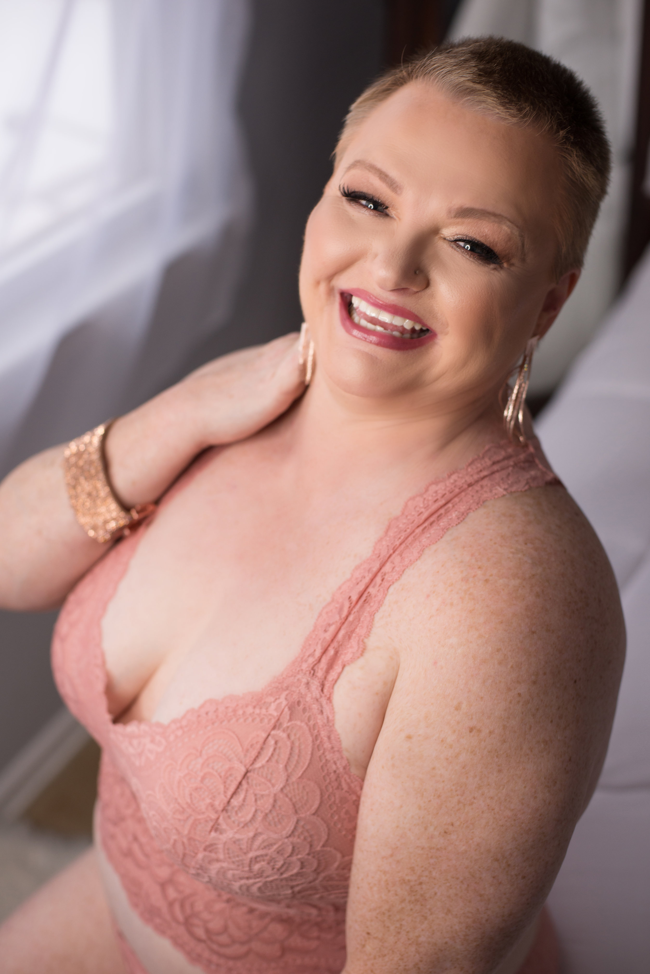 "Brave Boss Babe Connie - ""I had an amazing time at my boudoir photo shoot with Leah. Not only is she a warm, welcoming and inspiring woman, she is a fantastic photographer. I felt totally comfortable during the shoot and she kept me laughing the whole time. I was so excited to see my photos right after we finished and I couldn't believe how wonderful they turned out. The entire experience was such a confidence booster for me and I highly recommend having Leah as your photographer."""