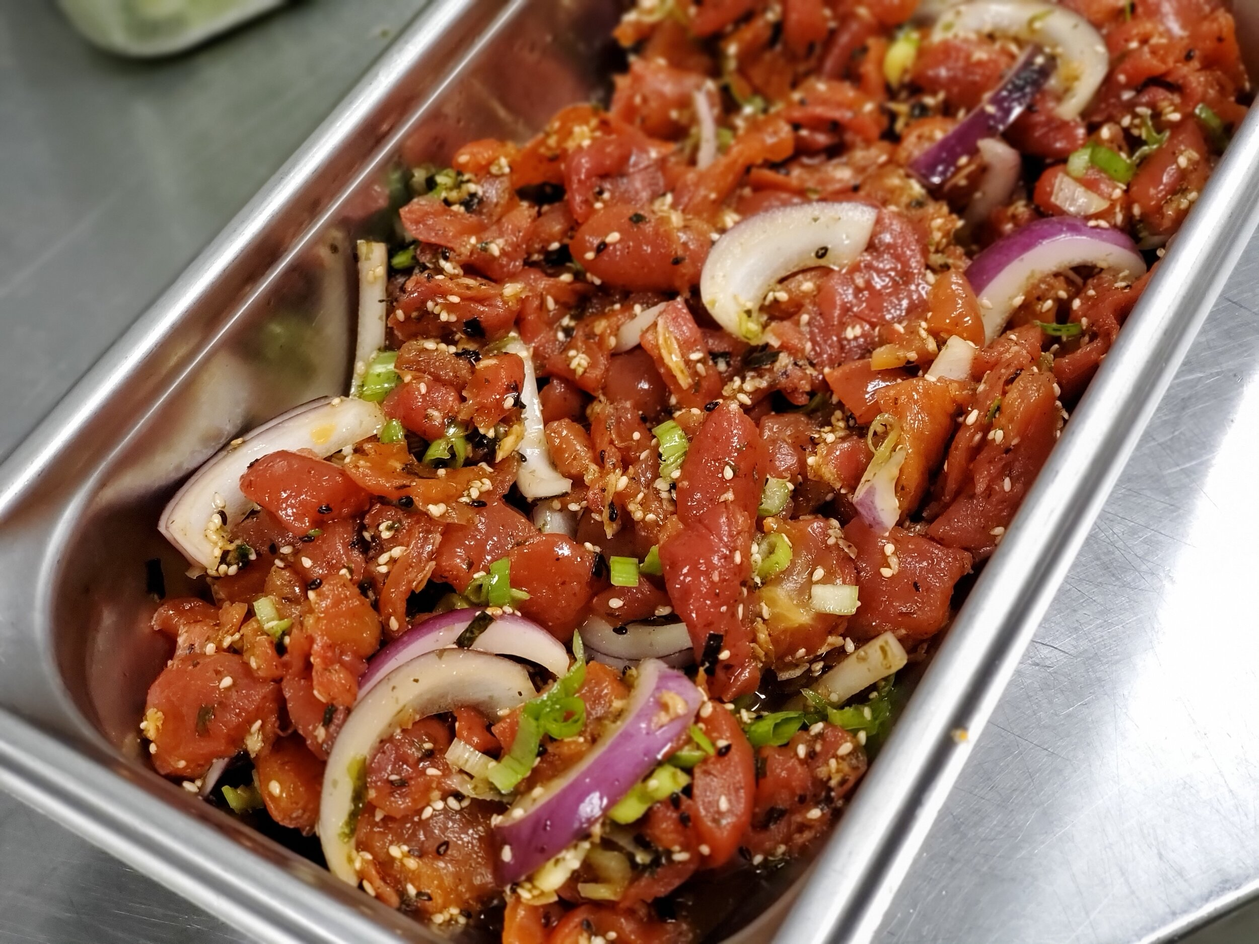 Marinated Ahimi with red and green onions, furikake, and sesame oil, topped with crispy onion s