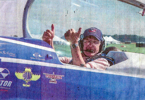 """Ready for take-off . Korean War veteran Richard """"Dick"""" Walters of Bath gives the thumbs-up before his flight with aerobatic pilot Rob Holland on Friday. The """"Honor Flight"""" is a program Holland started to thank veterans."""