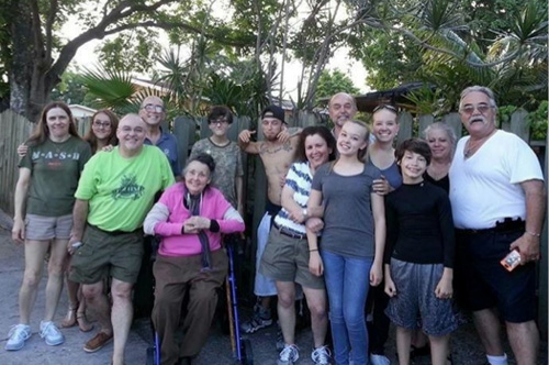"""This family photo was taken at a joint Mother's Day / """"Welcome Home, Chris"""" celebration in Miami. Chris is in the back row, third from the left, wearing glasses. Seeing the happy, smiling, joyous feeling on the faces of the Carlisle family expresses the sense of accomplishment and success that the United Veterans Services volunteers feel on a daily basis as they work with veterans all across the country."""