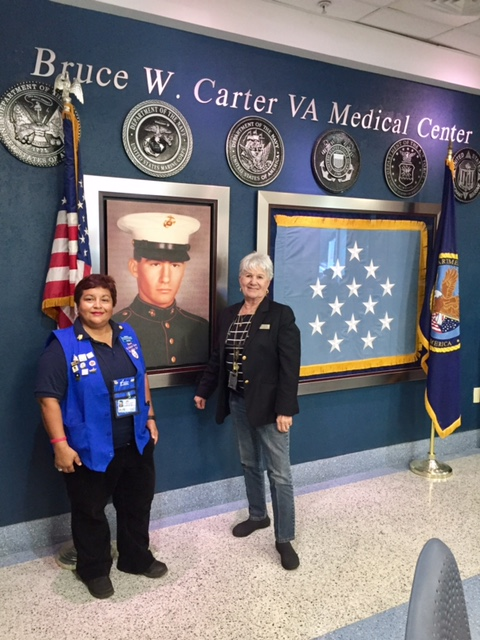 Pictured here (click photo to enlarge) is Maria Lacayo VAVS Rep. at the Miami VA Medical Center and Georgie Krell past National President for the American Goldstar Mothers. The Miami VA Medical Center is named after Georgie Krell son Bruce W Carter who was killed in action during the Vietnam War. He was posthumously awarded the Medal of Honor for his heroism. Mrs. Krell is training volunteers to work at the greeter/information desk.