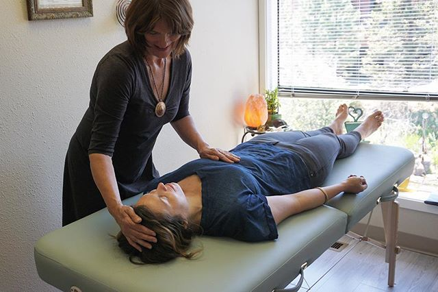 Energy Therapy - Anne is working with this clients Crown and Solar Plexus Chakras.