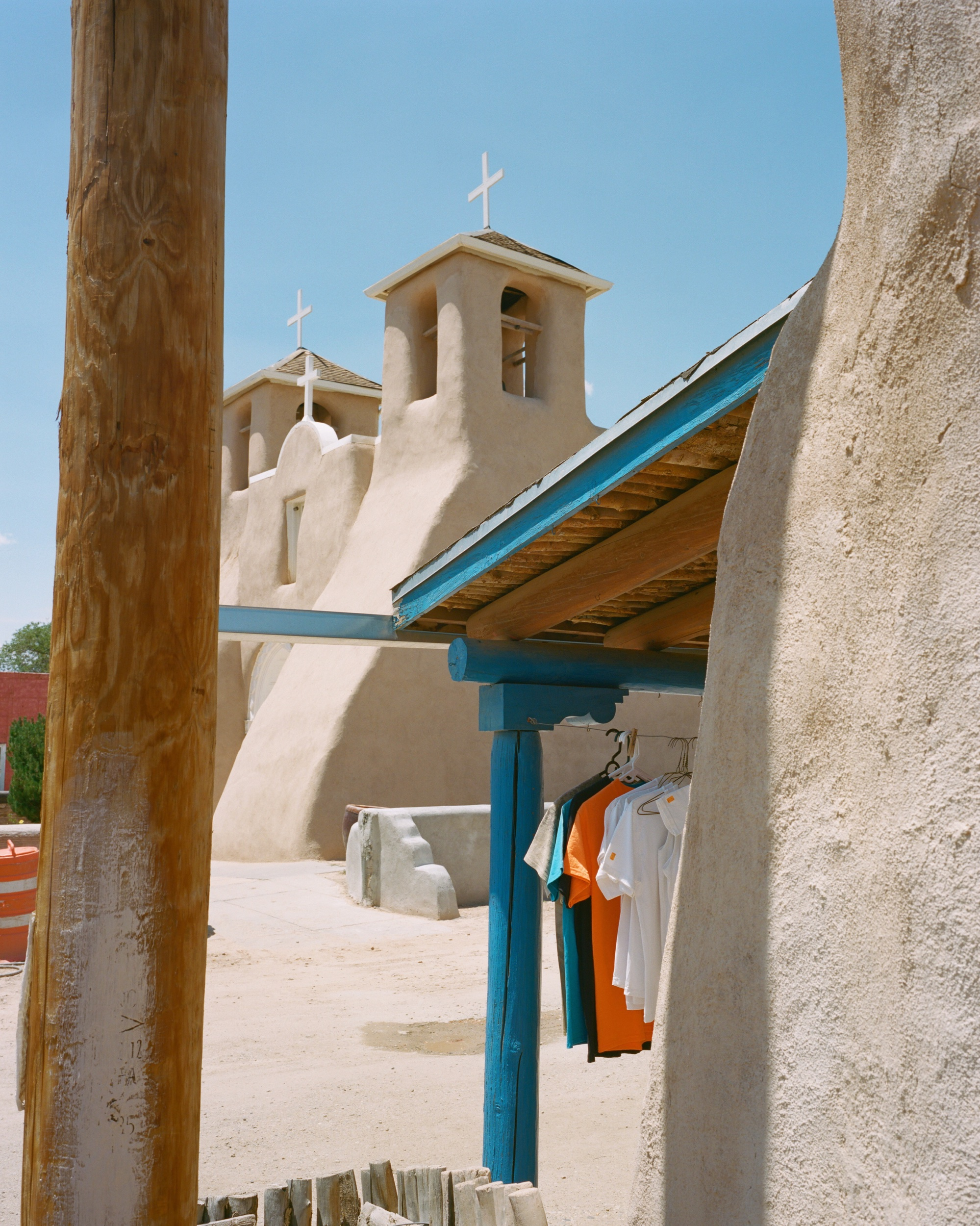 Gift shop t-shirts hanging in view of San Francisco de Asis Church, July 2019 - 120 Portra (6x7)