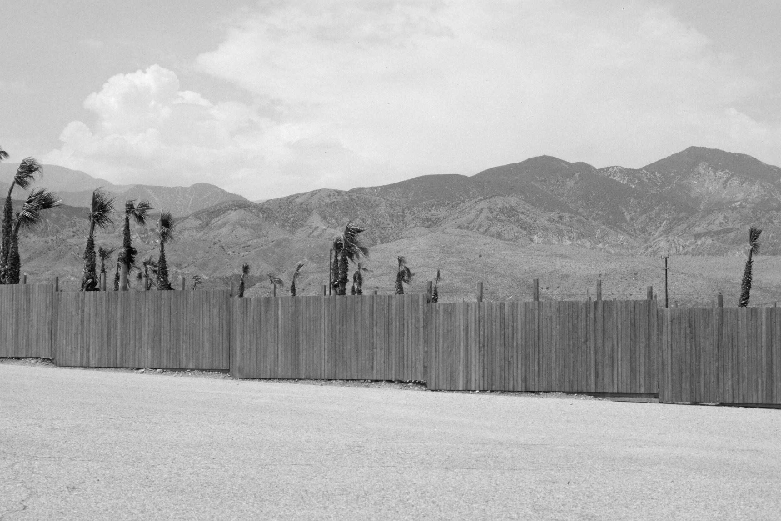 Fence in parking lot adjacent to the Cabazon Dinosaurs, 2008/9 - 35mm