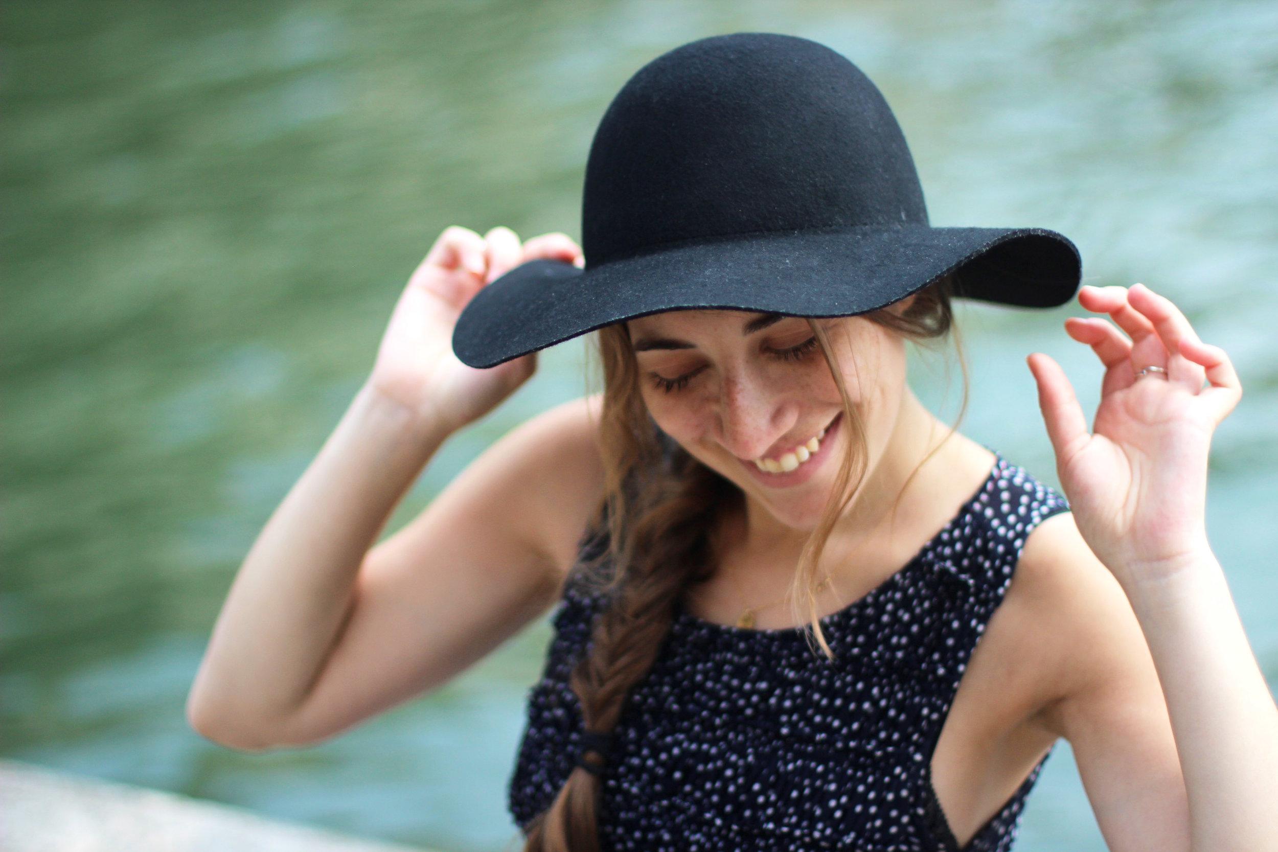 girl smiling hat close up happy original.jpg