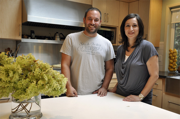 Sam Alhadeff and Renee Antezana stand together in the kitchen of their latest Mercer Island remodel project, the residence of Barby Cohen, Oct. 1. —image credit: Rebecca Mar/Staff Photo