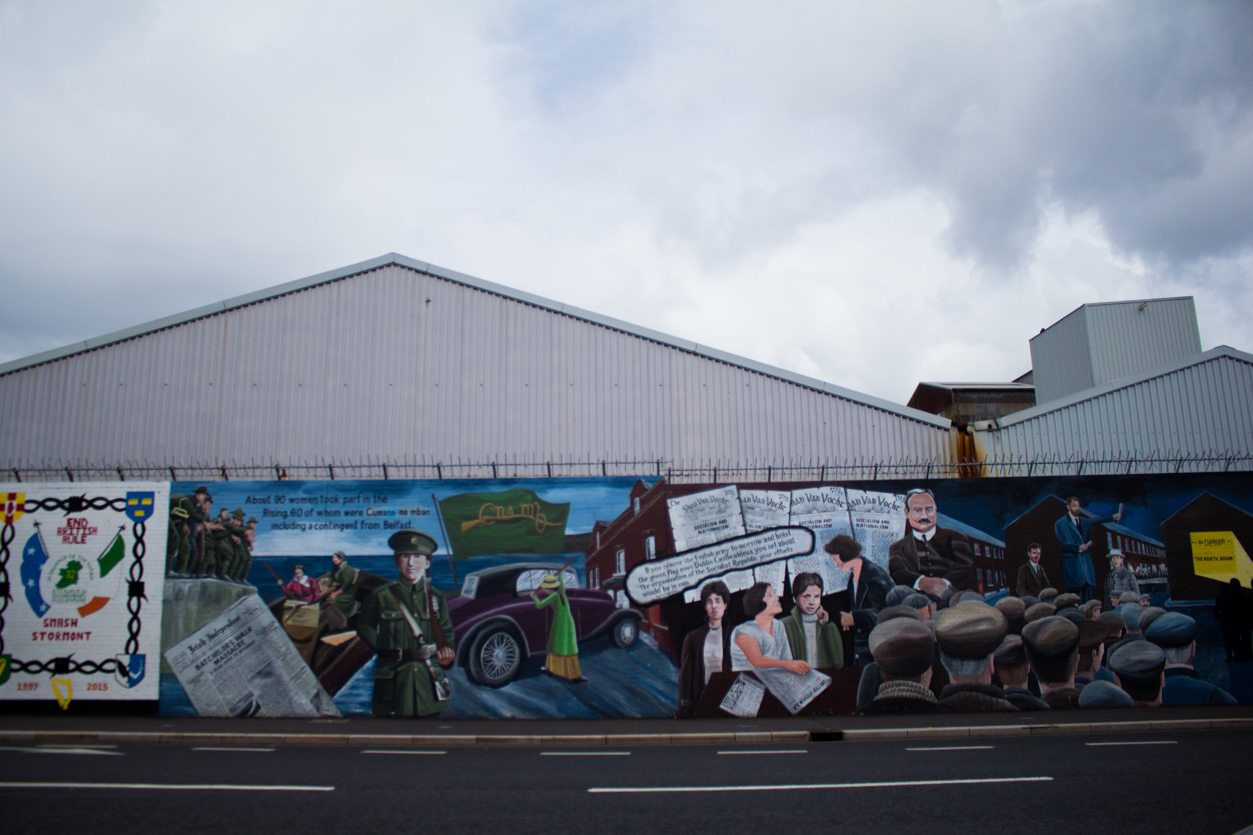 """The """"Peace Walls"""" (pictured) run along Falls Road, and through the rest of Belfast."""