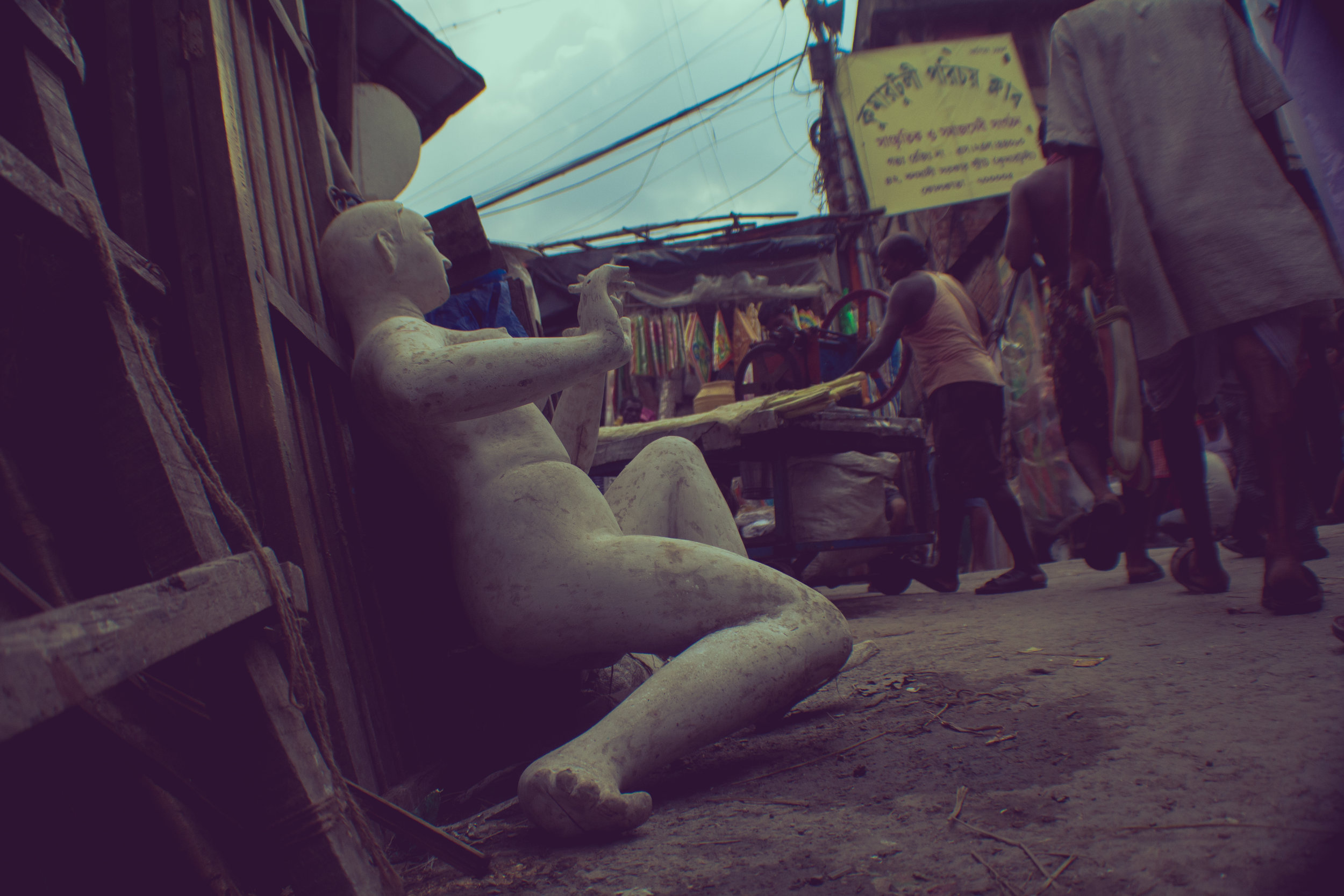 A half finished idol is left on the side of street in Kumartuli.
