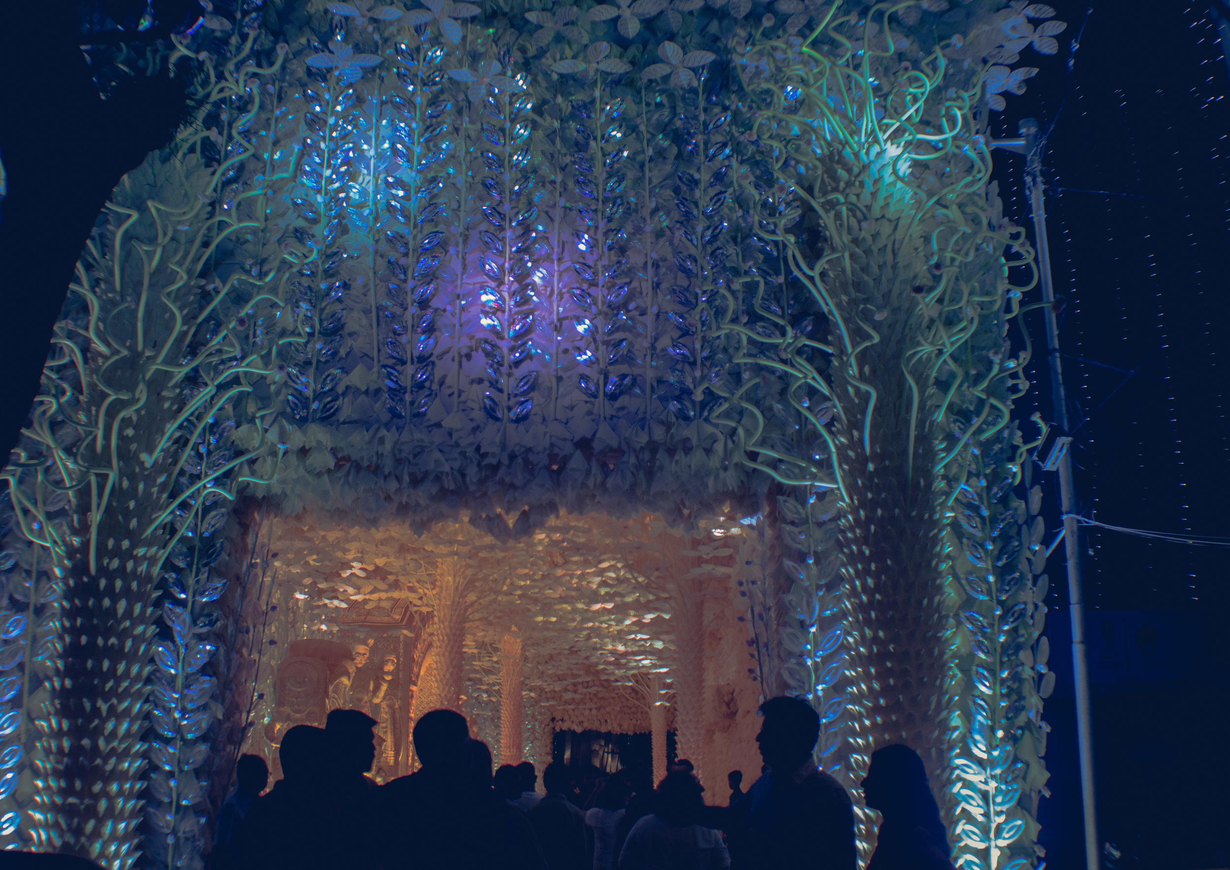 At the entrance to Mudiali Club, crowds of people gather on the third night of the festival to see Kolkata's artistry.