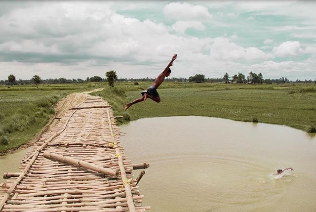 In 2017, the rural district of Malda experienced a devastating flood. Many watched their homes, their cattle, and their crops float away before their eyes. The wooden bridge seen here was built during the floods, so villagers could move to dry land. • • • • #malda #floods #ruralindia #incredibleindia #natgeoyourshot #natgeoindia #india #natgeotravel #travelphotography #outtakes