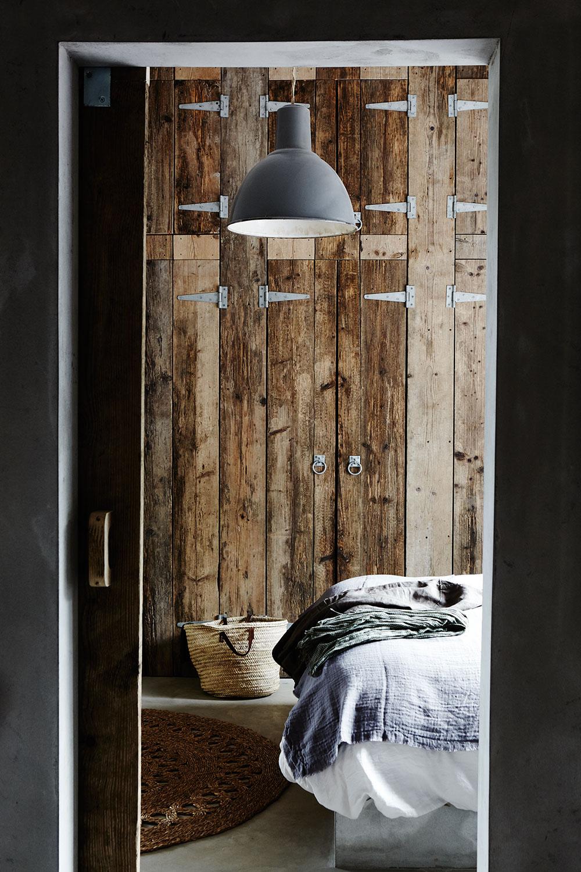 rustic_wood_panel_bedroom.jpg