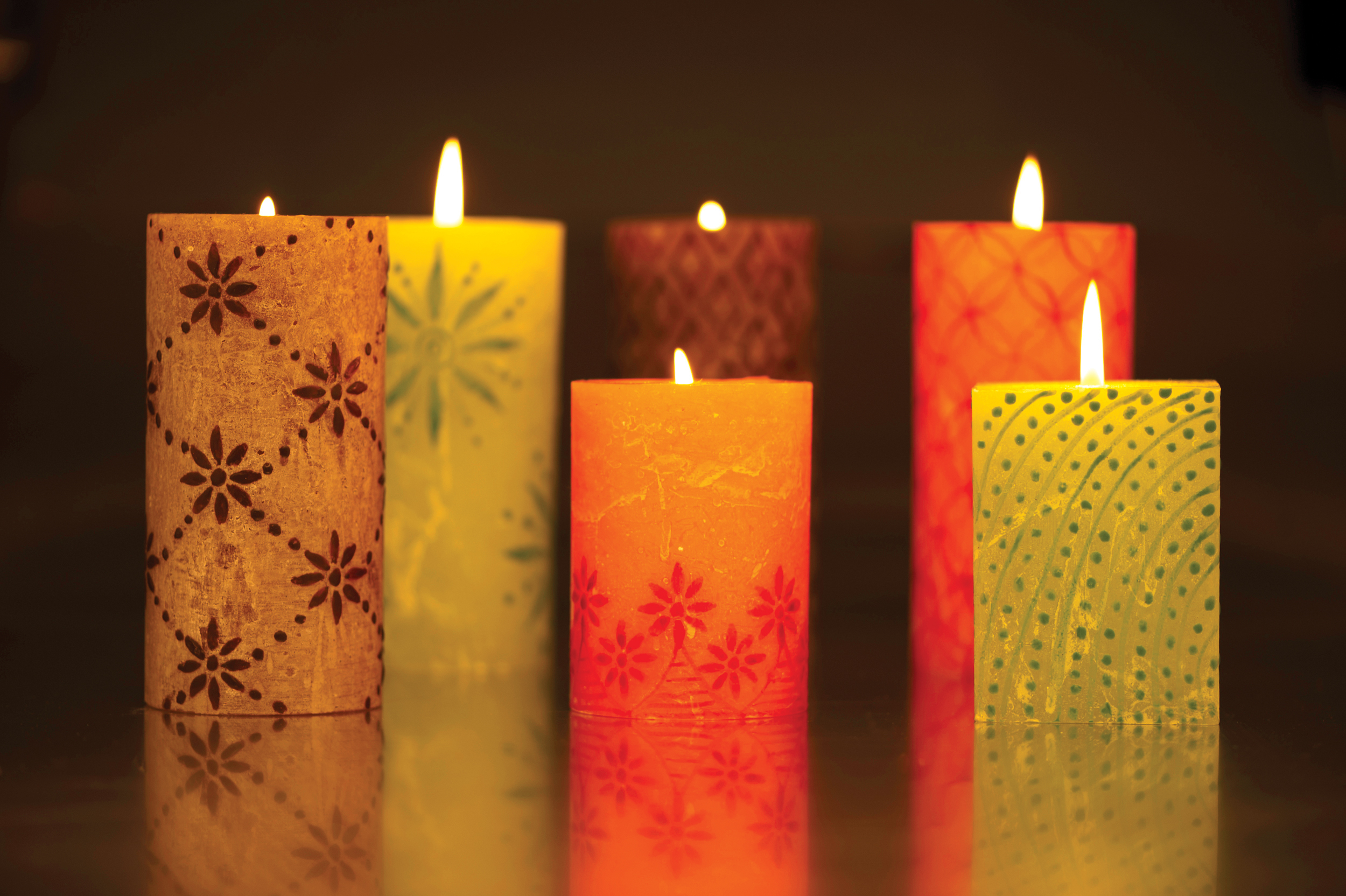 kapula-hand-painted-pillar-candles-lit-flame-glowing.jpg