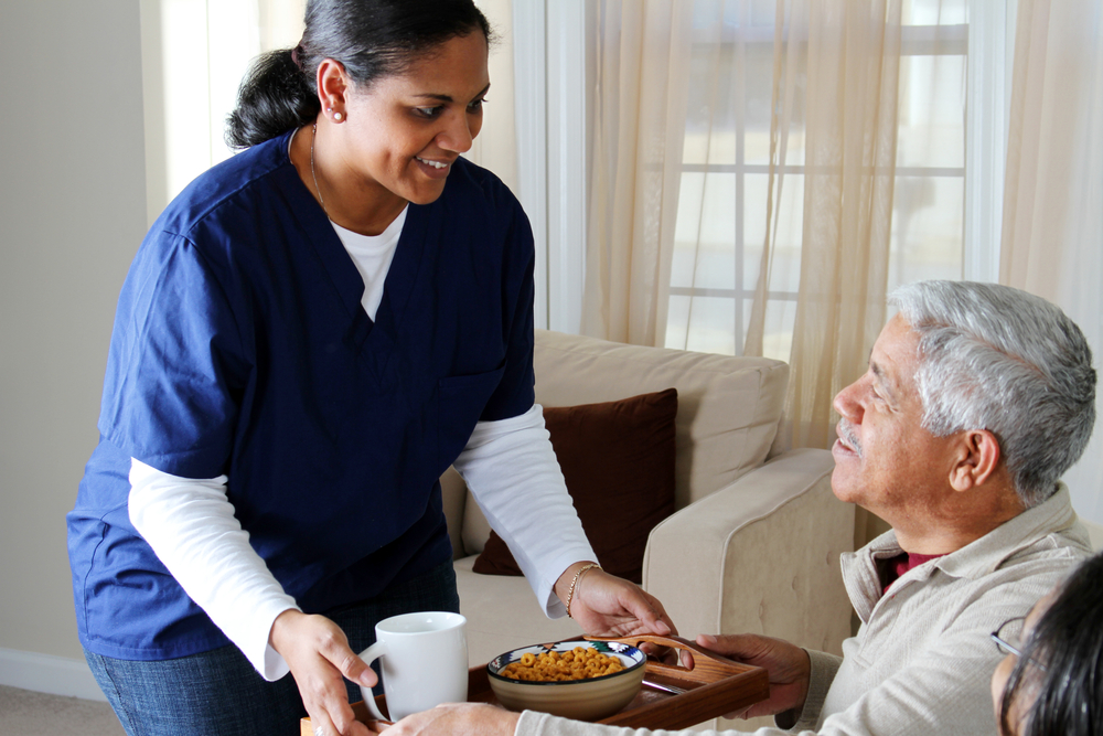 stock-photo-home-health-care-worker-and-an-elderly-couple-71309542.jpg