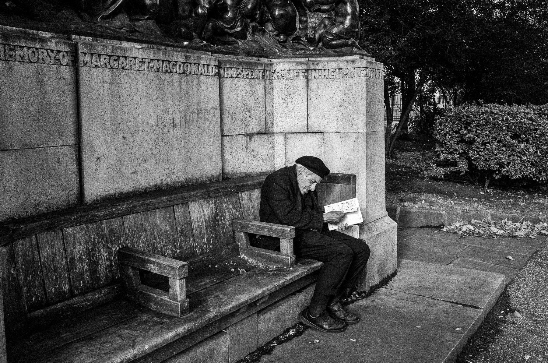 Reader on stony bench