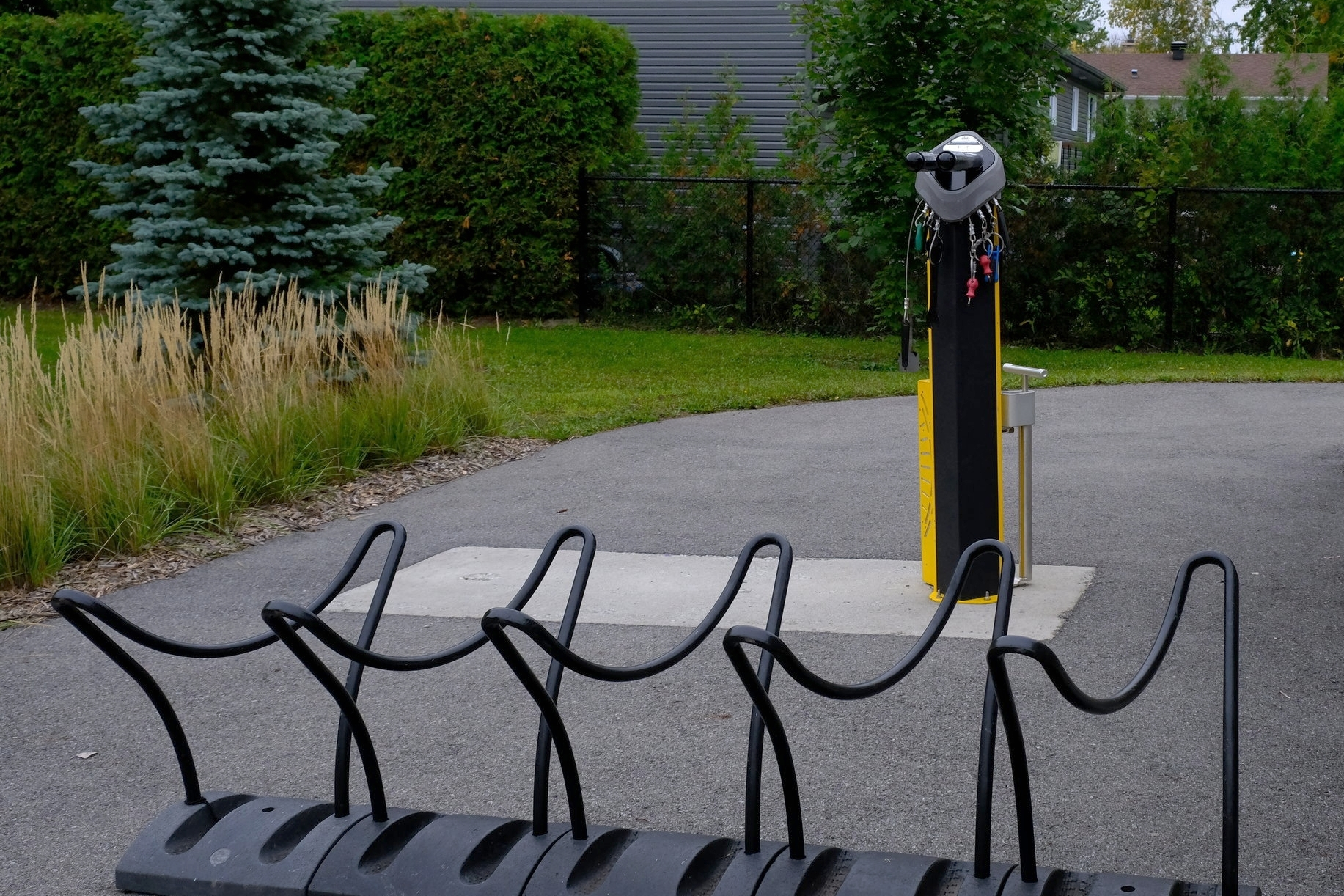 A bicycle repair station and bike parking alongside one of Candiac's off-street greenways.