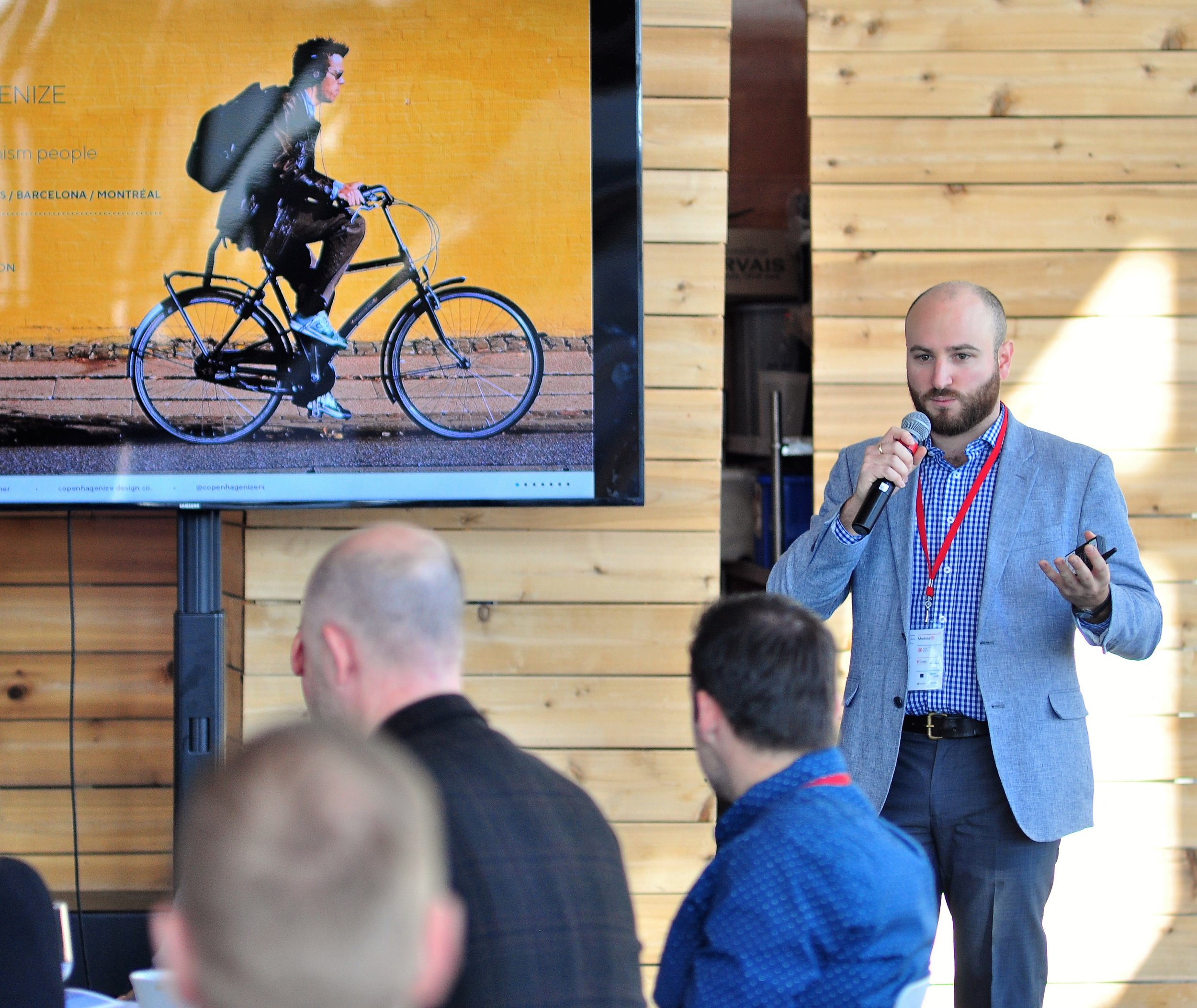 Michael presents on the potential of the bicycle to transform our cities at CanU10. (Council for Canadian Urbanism)