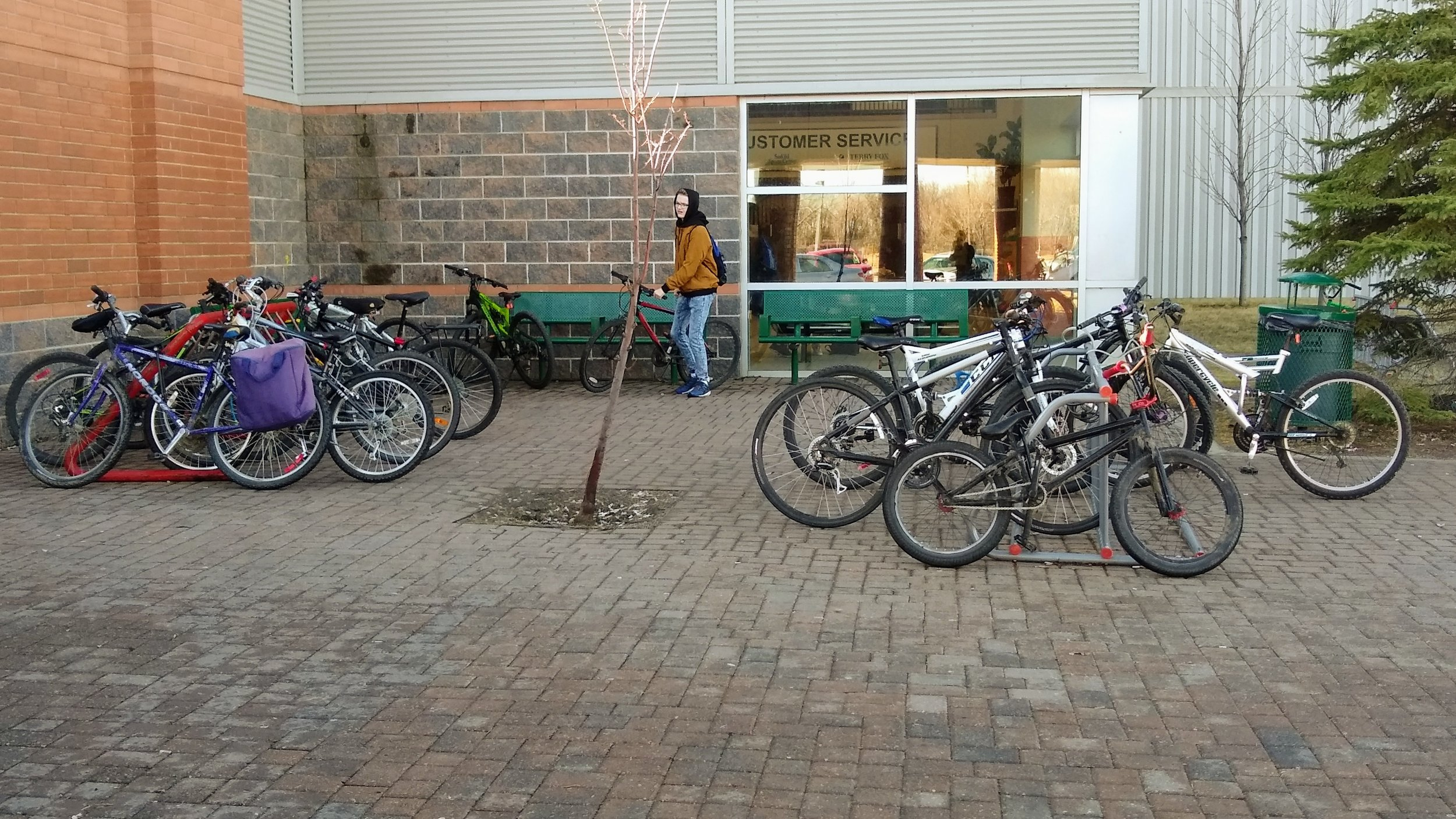 Bikes parked outside a Saskatoon high school show that even highschoolers do commute by bike.