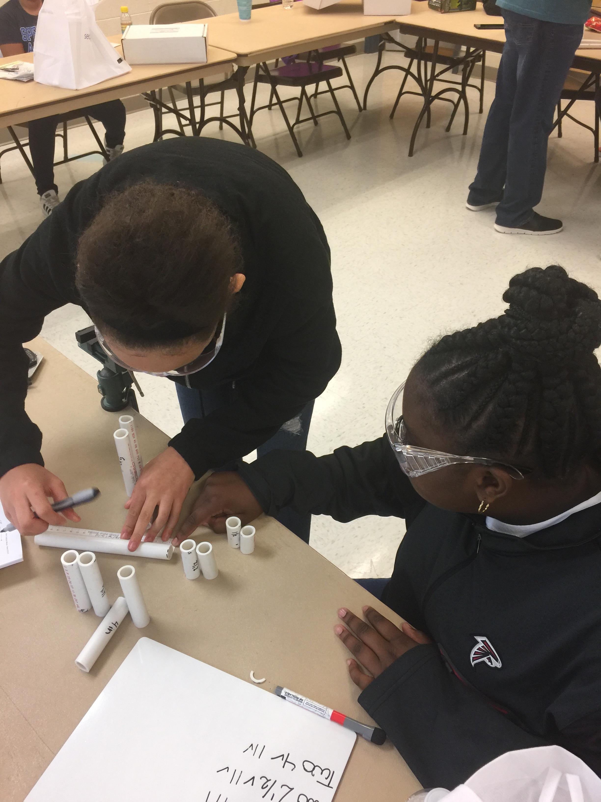 Girls from Black Girls Dive Foundation building their Underwater Remotely Operated Vehicles