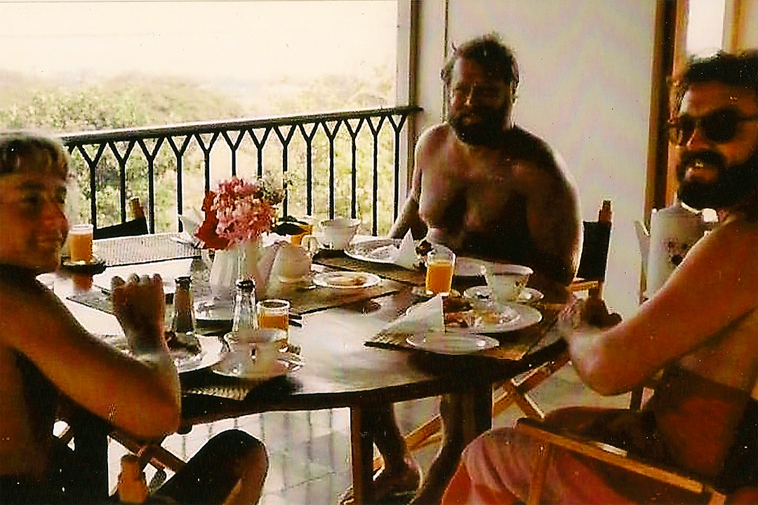Having breakfast on the veranda. Me (front left), My Dad, Gary, (back center) and Mike wearing the shades (right).