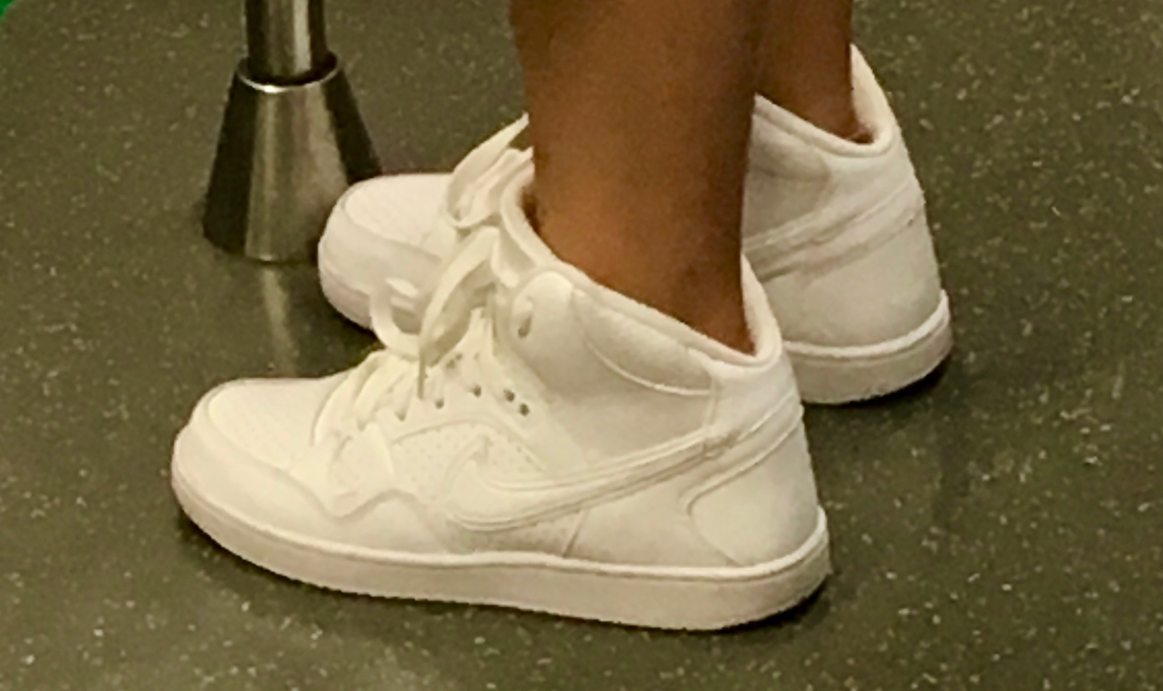 Someone is trying really hard to make a fake less obvious on this one, a subtle double swoosh, but the last and sole are off too. Nice try!