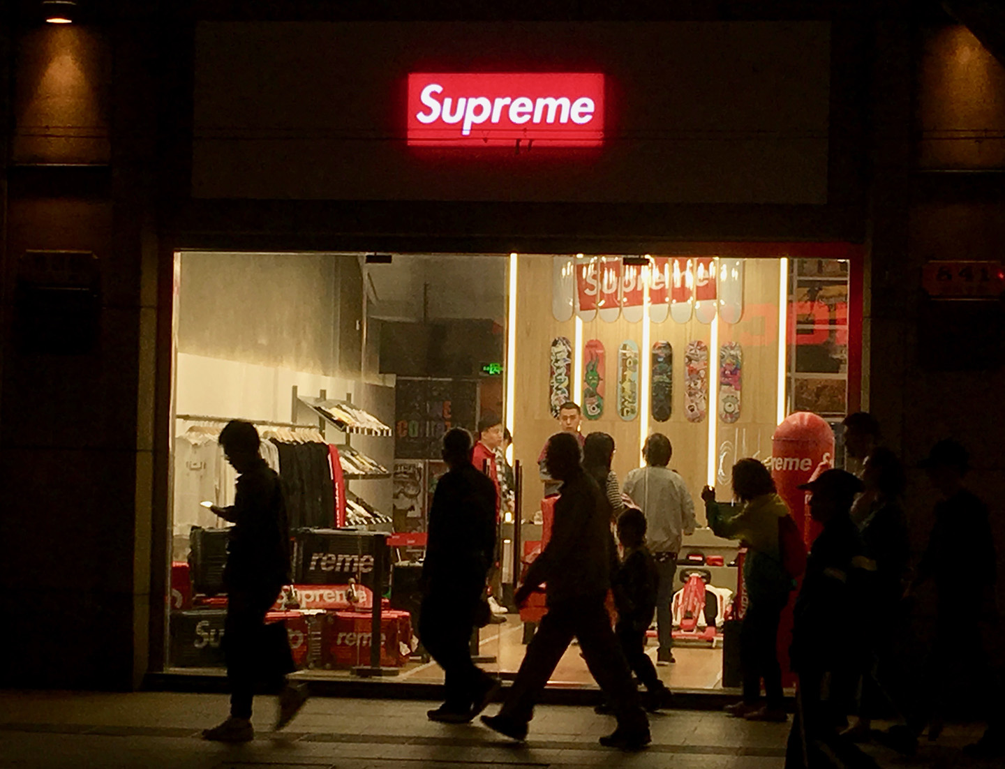 A night shot of a store front.