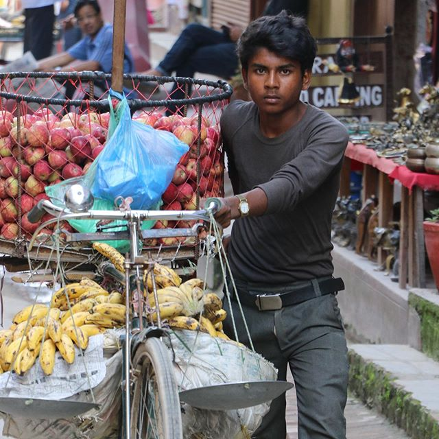 Apples & Bananas • • #nepal #oldpatan #fruitmarket #worldtravel #followme #artistsoninstagram #artistoninstagram #shotwithiphone #peoplephotography #humanity #apple #banana
