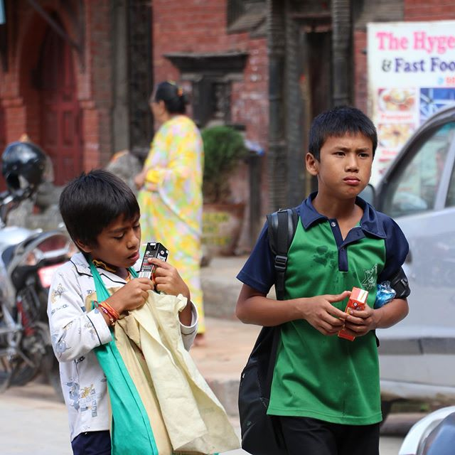 Brothers & Juice • • • #photography #travelphotography #portraits #realism #nepal #kathmandu #oldpatan #children #juicebox #people #candidphotography