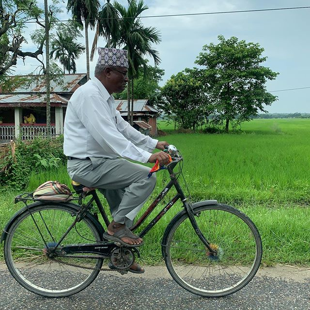 Biking & White • • • #streetphotography #nepal #bike #manonbike #green #blue #travelphotography #roadtrips