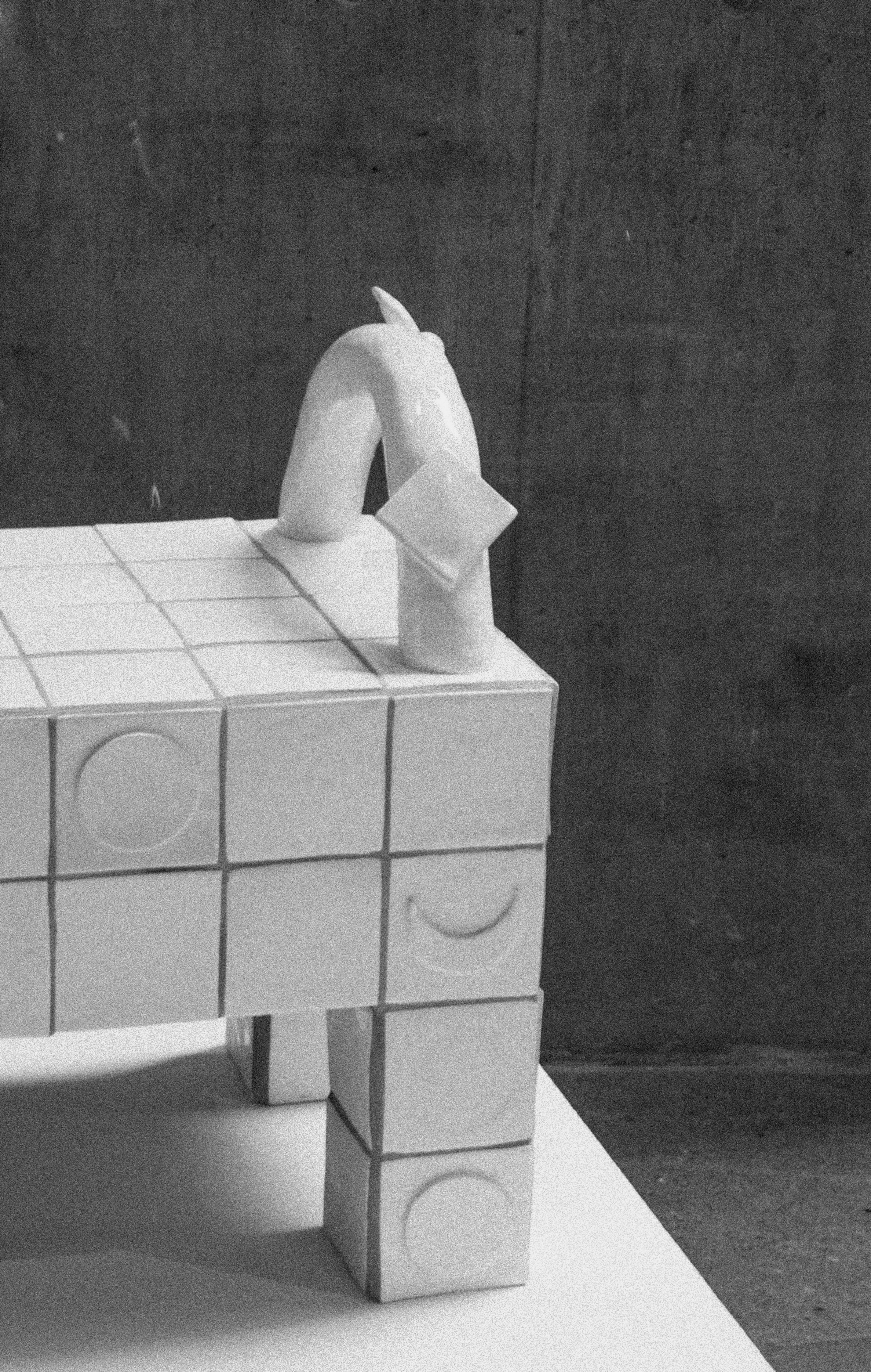 A set of surrealist and sculptural furniture, in hand sculpted ceramic tiles. One-off chair, bench, side table/tool, and coffee table.